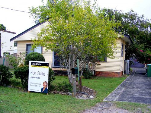 The artist's home at Alexandra St. Budgewoi until he was driven into homelessness. The agent's sign is on the front lawn
